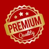 Χρυσός σφραγιδών εξαιρετικής ποιότητας σε ένα κόκκινο υπόβαθρο Στοκ φωτογραφίες με δικαίωμα ελεύθερης χρήσης