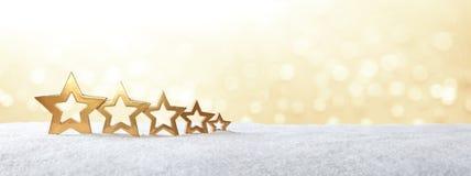χρυσό έμβλημα χιονιού 5 αστεριών Στοκ Φωτογραφίες