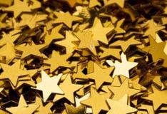 χρυσό αστέρι ανασκόπησης Στοκ Φωτογραφίες