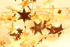 χρυσό αστέρι γιρλαντών Στοκ Εικόνες