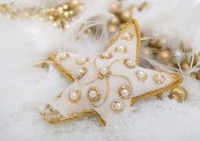χρυσό αστέρι χιονιού Στοκ Εικόνες