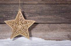 Χρυσό αστέρι Χριστουγέννων Στοκ Φωτογραφίες