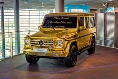 Χρυσό αυτοκίνητο Στοκ Εικόνες