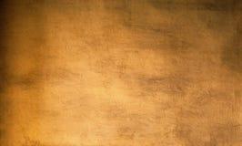 Χρυσό αφηρημένο υπόβαθρο με τη σύσταση και τις σκιές, παλαιό vintag στοκ εικόνες