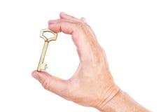 Χρυσό βασικό διαθέσιμο σύμβολο χεριών του πλούσιου σπιτιού. Στοκ φωτογραφία με δικαίωμα ελεύθερης χρήσης