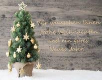 Χρυσό διακοσμημένο χριστουγεννιάτικο δέντρο, μέσα καλή χρονιά Gutes Neues Στοκ Φωτογραφία