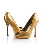 Χρυσό ζευγάρι των παπουτσιών γυναικών Στοκ φωτογραφίες με δικαίωμα ελεύθερης χρήσης