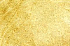 Χρυσό κατασκευασμένο υπόβαθρο watercolor Αφηρημένη χρυσή ακτινοβολία Στοκ Εικόνες