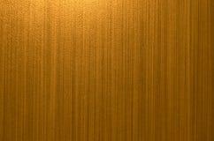 Χρυσό καφετί υπόβαθρο σχεδίων γραμμών στοκ φωτογραφία με δικαίωμα ελεύθερης χρήσης