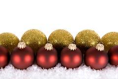 χρυσό κόκκινο διακοσμήσεων Χριστουγέννων Στοκ Φωτογραφία