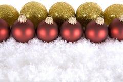 χρυσό κόκκινο διακοσμήσεων Χριστουγέννων Στοκ Εικόνες