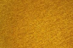 Χρυσό λαμπρό ύφασμα, υπόβαθρο ή σύσταση στοκ φωτογραφία με δικαίωμα ελεύθερης χρήσης