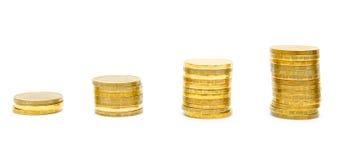 χρυσό λευκό νομισμάτων ανασκόπησης Στοκ Εικόνες