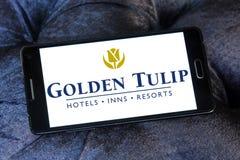 Χρυσό λογότυπο ξενοδοχείων και θερέτρων τουλιπών Στοκ Εικόνες