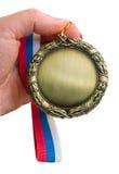 χρυσό μετάλλιο χεριών Στοκ Εικόνες