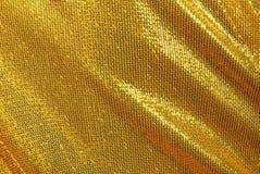 χρυσό μετάξι υφάσματος ιματισμού ανασκόπησης Στοκ εικόνες με δικαίωμα ελεύθερης χρήσης