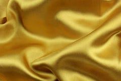 χρυσό μετάξι υφάσματος κυματιστό Στοκ Εικόνες