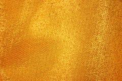 Χρυσό μετάξι υφάσματος Στοκ Φωτογραφίες