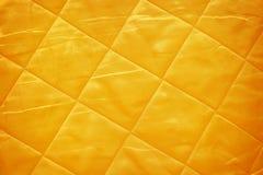 Χρυσό μετάξι υφάσματος Στοκ εικόνες με δικαίωμα ελεύθερης χρήσης