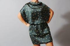 χρυσό μοντέλο μόδας φορεμ Στοκ Φωτογραφίες