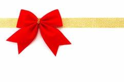 χρυσό περικάλυμμα δώρων Στοκ Εικόνες