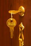χρυσό πλήκτρο υγείας Στοκ εικόνα με δικαίωμα ελεύθερης χρήσης