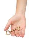 χρυσό πλήκτρο χεριών Στοκ φωτογραφία με δικαίωμα ελεύθερης χρήσης