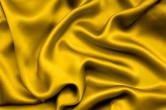 χρυσό σατέν ανασκόπησης Στοκ Φωτογραφία