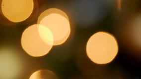 Χρυσό στρογγυλό έντονο φως από τα φω'τα φιλμ μικρού μήκους