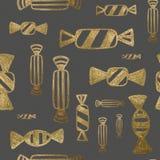 Χρυσό συρμένο χέρι σχέδιο Υπόβαθρο καραμελών Yummy απεικόνιση επιδορπίων ακτινοβολήστε άνευ ραφή&sig Στοκ φωτογραφίες με δικαίωμα ελεύθερης χρήσης