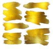 Χρυσό σύνολο απεικόνισης φύλλων αλουμινίου Να λάμψει λεκέδων χρωμάτων σύστασης Watercolor αφηρημένο κτύπημα βουρτσών για σας κατα Στοκ εικόνες με δικαίωμα ελεύθερης χρήσης