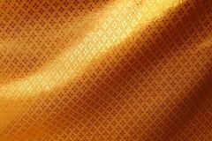 Χρυσό υπόβαθρο σύστασης μεταξιού Στοκ Εικόνα