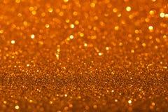 Χρυσό υπόβαθρο με τα σπινθηρίσματα Στοκ Εικόνες