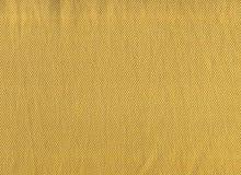 Χρυσό υπόβαθρο συστάσεων υφάσματος στοκ φωτογραφία