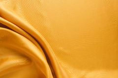 Χρυσό υπόβαθρο σύστασης υφάσματος Στοκ Εικόνες