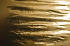 Χρυσό υπόβαθρο φύλλων αλουμινίου Στοκ Φωτογραφίες