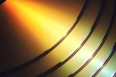 Χρυσό υπόβαθρο DVD Στοκ Φωτογραφίες