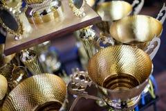 Χρυσό φλυτζάνι για το νικητή 1$η ανταμοιβή θέσεων Στοκ Φωτογραφία
