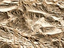 Χρυσό φύλλο αλουμινίου ως υπόβαθρο Στοκ Φωτογραφία