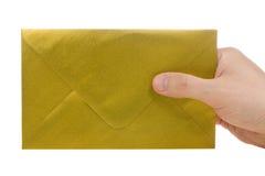 χρυσό χέρι φακέλων Στοκ Φωτογραφίες