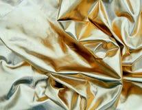 Χρυσό ύφασμα σατέν Στοκ φωτογραφία με δικαίωμα ελεύθερης χρήσης