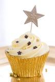 Χρυσό cupcake Στοκ Εικόνα