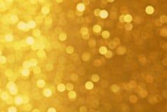 Χρυσό Defocused ακτινοβολεί Στοκ Φωτογραφίες