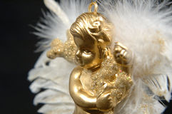 χρυσό IV μέρος διακοσμήσεων Χριστουγέννων αγγέλου στοκ φωτογραφίες