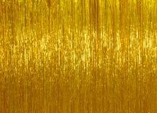 Χρυσό tinsel Χριστουγέννων υπόβαθρο Στοκ Φωτογραφία