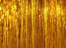 Χρυσό tinsel Χριστουγέννων υπόβαθρο Στοκ εικόνα με δικαίωμα ελεύθερης χρήσης
