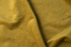 Χρυσό velour υπόβαθρο υφάσματος, βελούδο, μοχέρ, επίδραση κασμιριού στοκ φωτογραφία με δικαίωμα ελεύθερης χρήσης