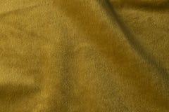 Χρυσό velour υπόβαθρο υφάσματος, βελούδο, μοχέρ, επίδραση κασμιριού στοκ εικόνα