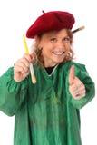 Χρωματίζοντας γυναίκα στο καπέλο και την πράσινη κάλυψη Στοκ Φωτογραφία
