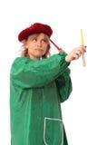 Χρωματίζοντας γυναίκα στο καπέλο και την πράσινη κάλυψη Στοκ φωτογραφία με δικαίωμα ελεύθερης χρήσης